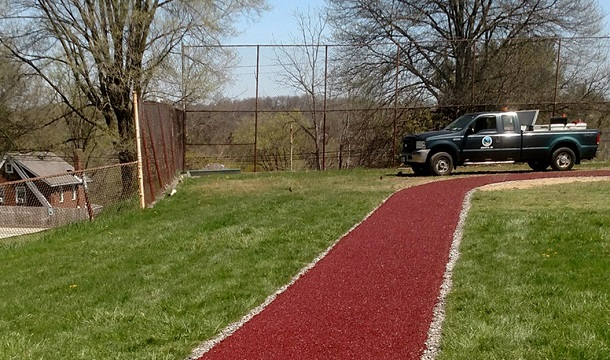 Rubberway Rubber Running Track at a Park provides a porous, non-slip, flexible, comfortable surface for walking and jogging